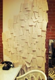 take pages from an old book and paste them to a plain wall to make it special!