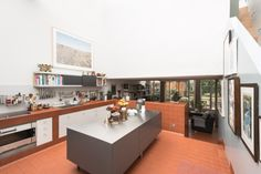 Red tiles run throughout the ground floor, from kitchen to sunken living space Mews House, Red Tiles, Rural Retreats, Beautiful Interiors, Ground Floor, Modern Architecture, Kitchen Dining, Living Spaces, Loft