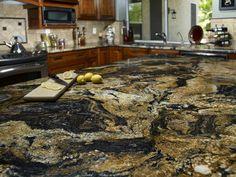 Volcano countertop with Tumbled Emperador Light backsplash Granite Kitchen Counters, Kitchen Countertop Materials, Tile Countertops, Granite Slab, Backsplash, Kitchen Cabinets, Granite Worktops, Kitchen Worktop, Black Granite
