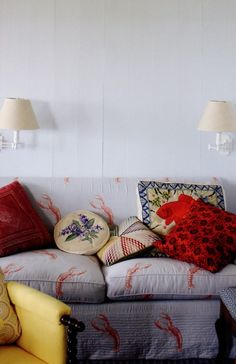 jeffrey bilhuber, waspy, lobsters, nantucket style, eclectic design, mix of pillows, sconces over sofa