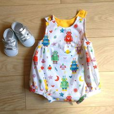 I love this robot fabric! Check out this cute romper for a newborn baby at kelakarclothing.etsy.com! #handmade #babyromper #babyplaysuit #babyonesie #robot #onesie #robots #robotbaby #robotonesie #robotclothes #cutebaby #homemade #babyclothes #forsale