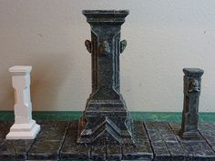 Dwarven Columns - Three types of dwarven columns, inspired in LOTR movies. They give the proper feeling of dwarveness without being too imposing in the table.