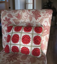 I crocheted this pillow front and sewed it to the front of the pillow that came with this chair because I don't like matchy-matchy pillows. Love the texture this adds to the room. Pattern is here - http://millemakes.wordpress.com/2011/05/22/something-pretty-the-pattern/