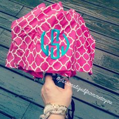 a rainy day calls for a bright monogrammed umbrella