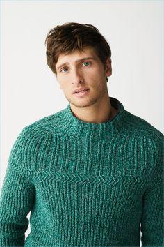 Tom Warren models a green sweater from Marc O'Polo's fall-winter 2018 range.