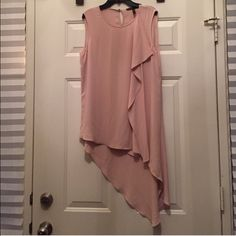 BCBG flowy peach tunic top BCBG flowy peach tunic top. Loose ruffle down left side. Beautiful piece to go with jeans or stretch pants. Polyester/washable worn once in excellent condition  BCBG Tops Tunics