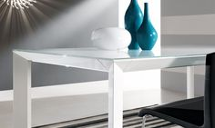 Table Manhattan by RIFLESSI  The Manhattan extendable dining table can seat up to 12 people. Featuring a metal frame and frosted glass top, this modern table is available in various colors with a matte or high gloss finish. The sliding mechanism allows the wood extension leaves to be stored inside the table top.      Available as standard in a white gloss finish.        http://www.format-store.com/en/prod/tables/tables-86/table-manhattan-by-riflessi.html