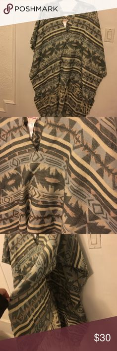 Free people poncho Free people Aztec design poncho. Very soft and never worn. Fringe around the bottom. Free People Tops Tunics
