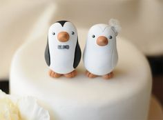 This listing is for a small set of penguin wedding cake toppers.    These are approx. 2-1/4 and 2-3/4 tall.    The groom shown here is black and