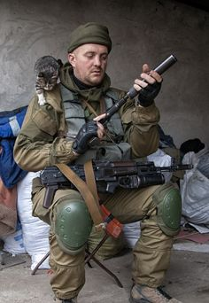 Russian? soldier with a cat and a silencer. [497x722]