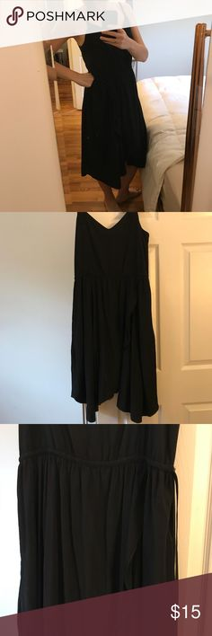 GAP black midi dress Asymmetric casual frock dress with string tie cinch waist and pockets. Like new, a little long for me. Pictured on 5'6 size 8 140 lbs. (Dress tag shows size 6 but I'm not a 6 in anything- fits more like a 9/10) GAP Dresses Asymmetrical