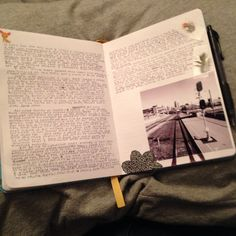 Journal with travel photos, bird feathers, and stickers. Handwriting