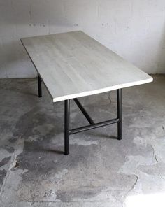 The reclaimed wood dining table's top has natural character