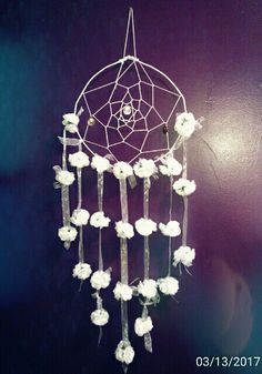 I made my twin daughter's dream catcher prettier with leftover wedding decorations!