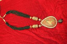 Pendant with meenakari work with emerald green beads..