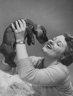 American singer Patti Page (famous for DOGGIE IN THE WINDOW) with dachshund.