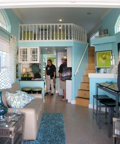 See the white railing at the far end of the cottage living space? It borders the guests' sleeping loft. It's a\ a tiny solar powered cottage. For more see: http://www.intimatehomedesigns.com/intimatehomedesigns/Blog__Loving_the_Home_youre_In/Entries/2012/2/11_A_Tiny_Solar_Cottage.html