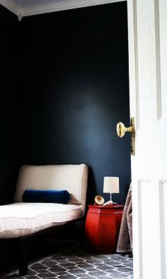 """... For the wall color, we chose a match to Farrow and Ball's Off-Black. It looks black, but is in fact a deep, dark Prussian blue. For someone who normally chooses shades of white, gray, and blue when making over rooms, I didn't know what we were missing! If you're brave enough, you may want to give it a go."" 