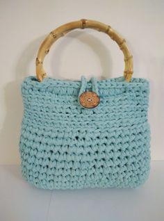crochet t shirt yarn bag, purse light blue with bamboo handles by yrozafcrocheting on Etsy Crochet T Shirts, Crochet Purses, Crochet Bags, Yarn Bag, T Shirt Yarn, Knitted Bags, Crochet Projects, Straw Bag, Purses And Bags