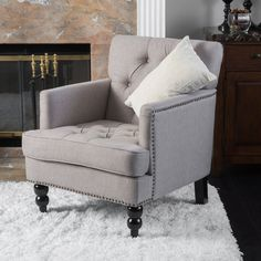Update your office or study with this contemporary club chair. Constructed with sturdy wood legs for durability and upholstered in a polyester blend fabric for ultimate comfort, this is a wonderful reading chair or guest chair to sink into and relax.