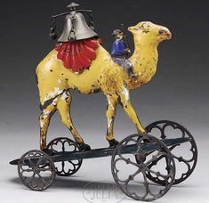 Antique camel bell toy with rider. May be Althof Bergmann and Co. or Gong Bell.