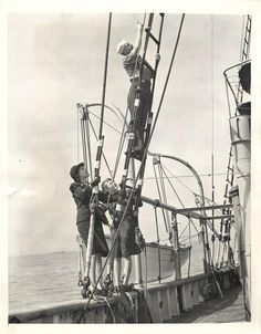"""1943- Girls of the U.S. SPARS with sailor aboard a Coast Guard vessel during """"sea voyage"""" off Norfolk."""