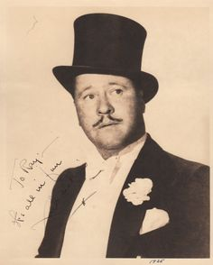 OAKIE JACK: (1903-1978) American Actor, remembered for his role as Napaloni in Charles Chaplin's The Great Dictator (1940). Vintage signed and inscribed sepia 8 x 10 photograph of Oakie in a head and shoulders pose wearing a top hat and white bowtie. Signed in dark fountain pen ink to the image, 'To Ray - It's all in fun, Jack Oakie', his signature running across a darker area although legible. Dated 1935 in another hand in fountain pen ink to the lower border.