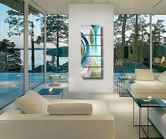 Bright Sun Room with White Contemporary Decor - Metal #Wall_art creates a beautiful focal point