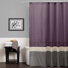 This dark elegant shower curtain turns an ordinary bathroom into a really special place. Fabricated with faux silk, the surface comes alive with pieced fabrics of purple, grey and ivory complemented with a pleated design running the width of the curtain.