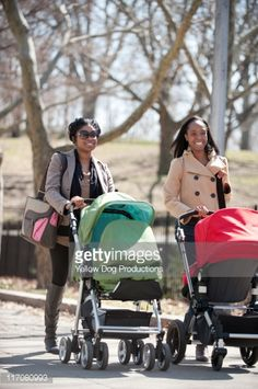 117080993-two-moms-pushing-babies-in-strollers-in-the-gettyimages.jpg 337×507 pikseliä