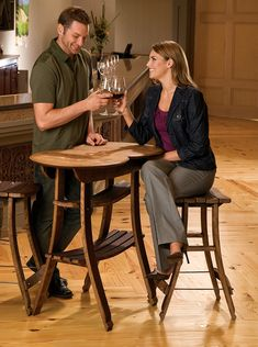 """Wine Barrel Stave Table and 2 Stools. The table comes with a removable serving and a handy shelf for storing. The stools are made entirely from barrel staves. Sturdily constructed with iron framing and finished with French wax. Table measures approximately 37""""H x 38""""W x 22""""D. Stool measures approximately 30""""H x 21""""W x 22""""D."""