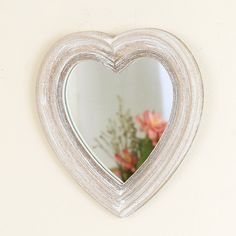 Made from wood that has been lightly coated in white paint to give a distressed feel that is reminiscent of driftwood, making this little mirror also great for the home that enjoys the nautical theme. Great Valentines Day gift.