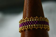 Beautiful beaded ring done in royal purple & gold seed beads and finished with a picot trim embelishment. Listing is for one ring. Please provide your ring size with purchase.
