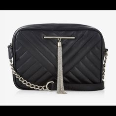 Express stitch metal tassel cross body bag A chain tassel, attractive chevron quilting and a metal and faux leather cross body strap make this essential storage option a fine fit for everything from work to weddings.  Cross body chain & faux leather strap Stitched chevron design on front Metal tassel embellishment Fabric lined   Ask if you have any questions. Express Bags Satchels