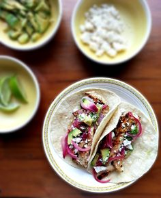 chicken carne asada tacos with red onion, avocado and crumbled cheese