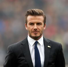 SEE THE WHOLE GALLERY! British football player David Beckham attends a meeting with the Youth Football Team at Hankou Literary and Sports Center in China.