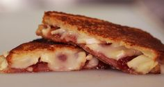Triple Brie Melt  Recipe from: Gorilla Cheese NYC  At New York City's Gorilla Cheese truck, their cheesy sandwiches stretch almost as long as the line-ups and customers go ape for their Triple Cream Brie and Smoked Gouda sammies.