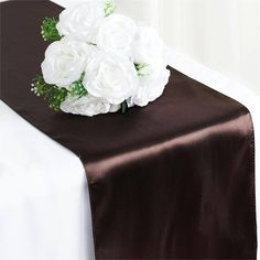 Chocolate Satin Table Runner   Satin has an unsurpassable sophistication and charismatic appeal about itself, it is undoubtedly, most preferred embellishing fabric that is adored by people all over the world and is tirelessly utilized in designing elegant formal attires, accessories, decorative flowers, ornaments and a lot more. The lustrous glossy texture of the fabric together with the seamless sheen and sublime elegance it exudes make it everyone's favorite all around the world. Spread…