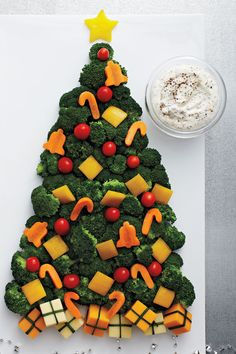 Roasted Garlic Dip—Our foolproof roasted garlic dip couldn't be simpler to make. Serve it with your favourite vegetables, or alongside festive Christmas Tree Veggie Tray. Christmas Tree Veggie Tray, Christmas Cheese, Santa Claus Christmas Tree, Christmas Party Food, Xmas Food, Christmas Appetizers, Christmas Cooking, Christmas Goodies, Christmas Treats