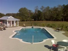 double end roman pool | Double Roman Pool with In-pool Side Bench Seat, Diving Well and Tri ...