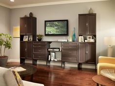 An entertainment center can be customized to fit all of your family's organization needs. #SuiteSymphony