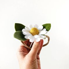 This listing is for one single Chamomile Flower Design. A White Chamomile Flower with Mustard Pom centre, and felt leaves in various shades of green. This floral design comes sewn on a nude nylon band -- soft, stretchy, and able to fit most sizes, from newborn to adult, or an