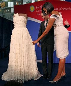 "FLOTUS Michelle Obama donates her Jason Wu inaugural gown to the Smithsonian National Museum of American History. Mrs. Obama's inaugural gown will be part of a new gallery, ""A First Lady's Debut,"" which will showcase 11 dresses worn by first ladies. Mrs. Obama wears a black and white painted rose silk twill gazar hand draped off-the-shoulder design from Mr. Gurung's Spring 2010 collection."