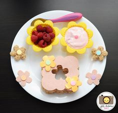 flower fun lunch;   cheese, turkey bologna, yogurt and raspberries.  For a how to follow this link  www.meetthedubien...
