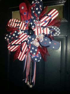 "Patriotic flip flop wreath - so simple hot glue flip flops to styrofoam wreath and ""garnish"" with your creative touches our flip flops came from Dollar General $1 per pair !  Ribbon and buttons to decorate - additional ornaments came from Dollar Tree items !"