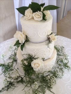 White Buttercream Wedding Cake with scrolls and SUGAR ROSES