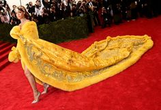 Rihanna Wears a Majestic Couture Cape to the Met Gala...And Nothing Else!   - ELLE.com