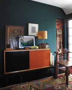 In the den, the cabinet is by George Nelson, the chair is by Garry Knox Bennett, and the kilim  is from ABC Carpet & Home.