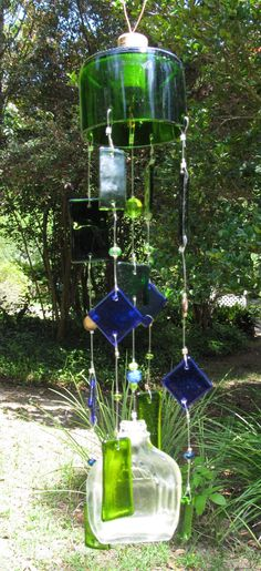 Up-cycled bottle wind chimes    @Jess Pearl Pearl Pearl Pearl Pearl Liu Massoth Home & Life so cute!