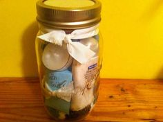Relaxation in a jar.  Put scented tea lights, travel sized body wash and lotion, bath salts, bubble bath, wash cloth, incense, etc. in a mason jar.  Makes a nice gift